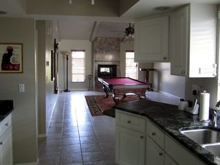 Vacation Homes in Marco Island house photo - Kitchen Opening Up Onto Pool Table Room