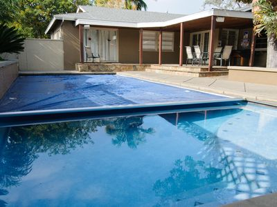 The private heated swimming pool features an automatic safety cover.