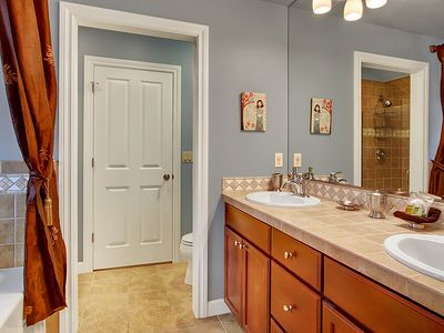 Full Bathroom - Large bathroom features deep tub, his and her sinks, separate glass shower and commode.