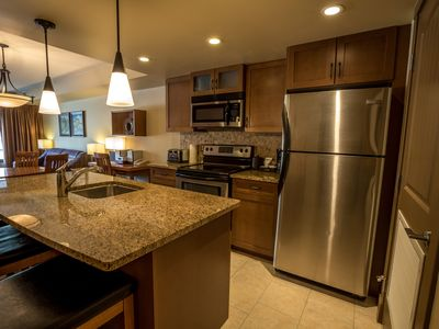 Enjoy a gourmet kitchen with stainless steel appliances