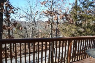 Branson cabin photo - Large deck with lounge furniture is great for dining or relaxing. Private road