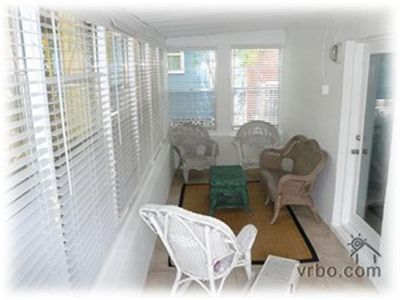 Enjoy coffee in the mornings or cocktails at sunset in the encl front sunroom.