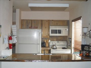 Our sweet little kitchen, cabinetry and woodwork by Gunnison Artisan.