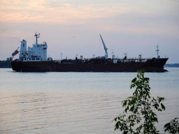 One of large ships that pass by on the St. Lawrence River in from of Maple Grove