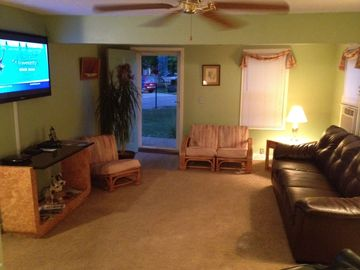 Living room includes 51-inch flat screen TV and DVD player