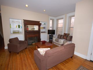 Capitol Hill apartment photo - Bright open living room with cable TV, Wifi, decorative fireplace