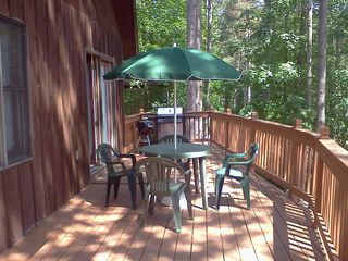 Crystal Mountain, Thompsonville cabin photo - Outdoor deck off of dining room, with charcoal and propane grills.