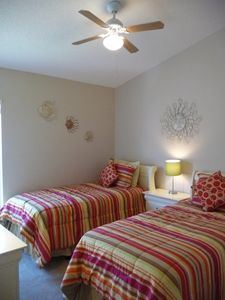 Quality twin beds, ceiling fan, dresser, closet