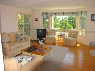 New Seabury house photo - sunny, open living room with ocean view