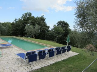 Penna in Teverina villa photo - This stone and terra cotta pool is invisible but only steps away from the house.