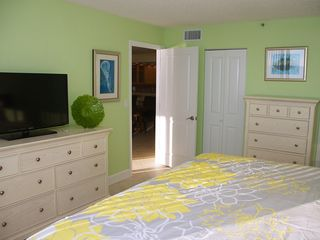 Redington Shores condo photo - Flat screen TV and walk in closet in the master bedroom.