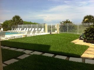 Cocoa Beach condo photo - Walkway to pool/ beach few steps away from condo