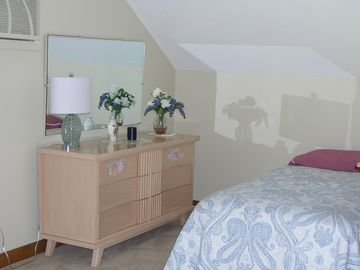 Bureau and additional twin bed in the master bedroom with the king bed.