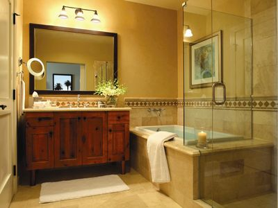 Spacious Bath with Separate Stone Walkin Shower and Tub and Designer Toiletries