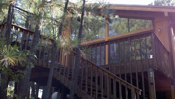 Flagstaff cabin rental - Exterior Photo of front deck at Rustic Mountain Home