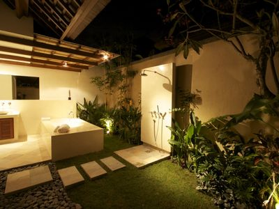Private garden bathroom with open 'rain' shower