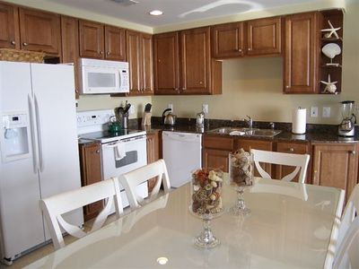 Gourmet Kitchen, Granite tops and large dining table that can seat 8.