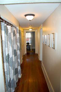 Hallway: View From Kitchen. Laundry Behind Curtain on Left.