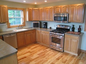 Chef's kitchen with wine storage, double oven, dishwasher and refrigerator