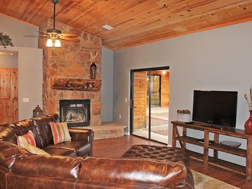 Pinetop cabin rental - Main house, great room with sectional and fireplace.