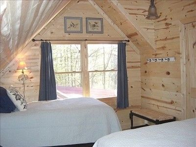Loft bedroom with 2 twin beds and large full, private bath.
