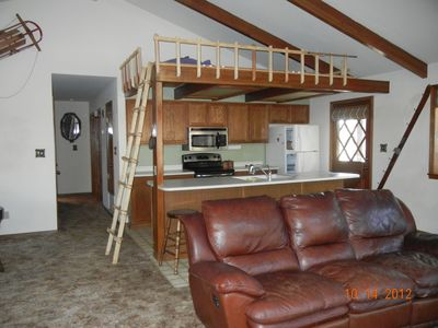 Munds Park chalet rental - Great room includes living room, dining room and kitchen (with loft above)