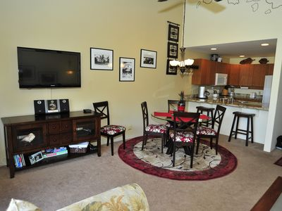 Living room/Dining room with flatscreen and stereo.