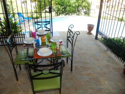 Enjoy The Morning And The Pool View: Dining Area On Covered Terrace Set For 4