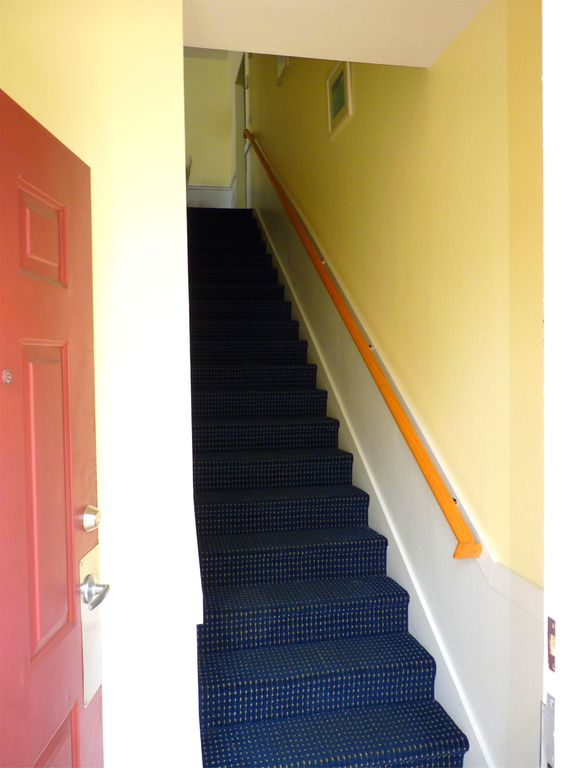 Private, secure entry. Carpeted stairs lead up to your vacation retreat.