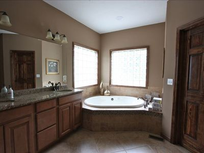 Master bath with walk in tiled shower, garden jetted tub, granite counter top