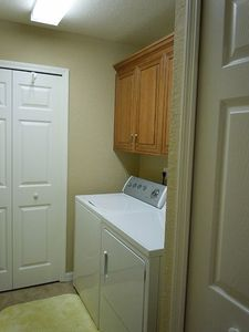 Laundry room, new cabinets, tiled floor.
