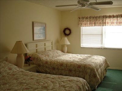 Master Bdrm--2 queen beds, cable t.v. Relax and listen to the waves or watch t.v