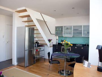 Kitchen - Stairs lead up to loft / secondary sleeping area.