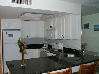 Recently remodeled kitchen with granite countertops.