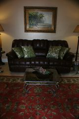 Carlsbad condo photo - tropical oil painting brown leather couch put your feet up on both ends