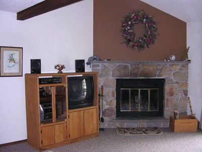 The living room fireplace and entertainment center.