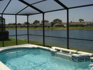 Sunset Lakes house photo - Relax by your own private pool, right on the lake!