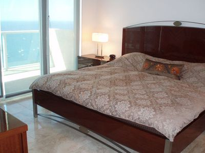 Master bedroom with balcony access and view of Biscayne Bay.