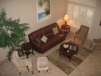 Formal living room area with 16 Foot Cathedral Ceilings and Plantation Shutters.