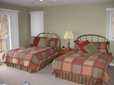 2 guest bedrooms with two double beds and attached baths