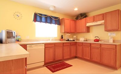 Spacious kitchen with counter seating and TV