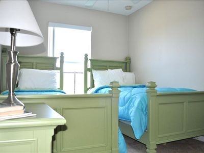 Fifth Bedroom, Twin Beds, large closet and view of Swimming Pool and Pond.