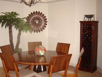 Dining area, rare wood table and seating for 6