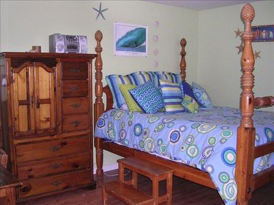 2nd bedroom with queen size bed, beach/surfer motif. Bed w/ memory foam topper.