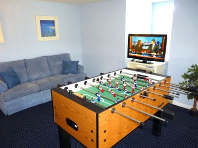 Sleeper sofa, Foosball Table, and Flat Screen TV in loft