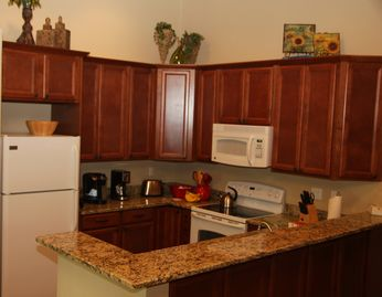 Brand New Kitchen with new cabinets, countertops, appliances and utensils