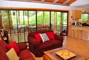 Comfortable living room and adjoined screened-in Lanai.