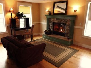 Poulsbo house photo - Private, Master Sitting Room w/ Custom, gas fireplace, and access to Sun Porch