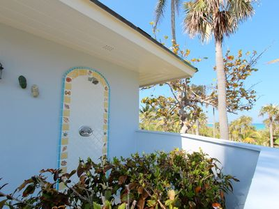 Double Bay estate rental - Master bedroom outdoor shower with ocean view (one of three outdoor showers!)