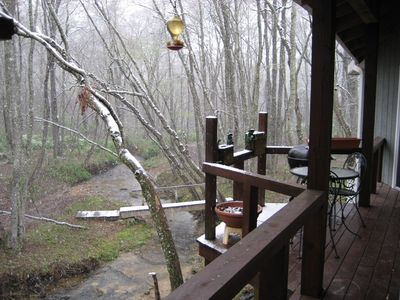 Relax to the soothing noise of Meadow Creek, right under the porch!!